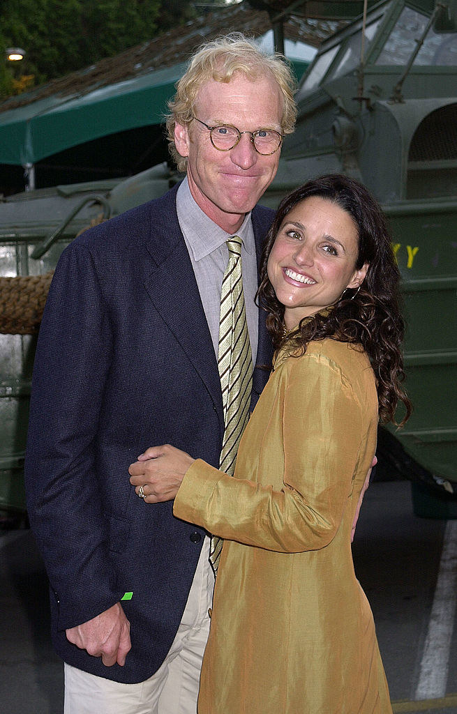 Brad Hall and Julia Louis-Dreyfus in a deep embrace