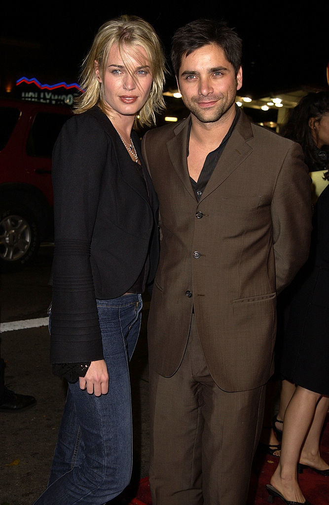 Rebecca Romijn and John Stamos at a movie premiere
