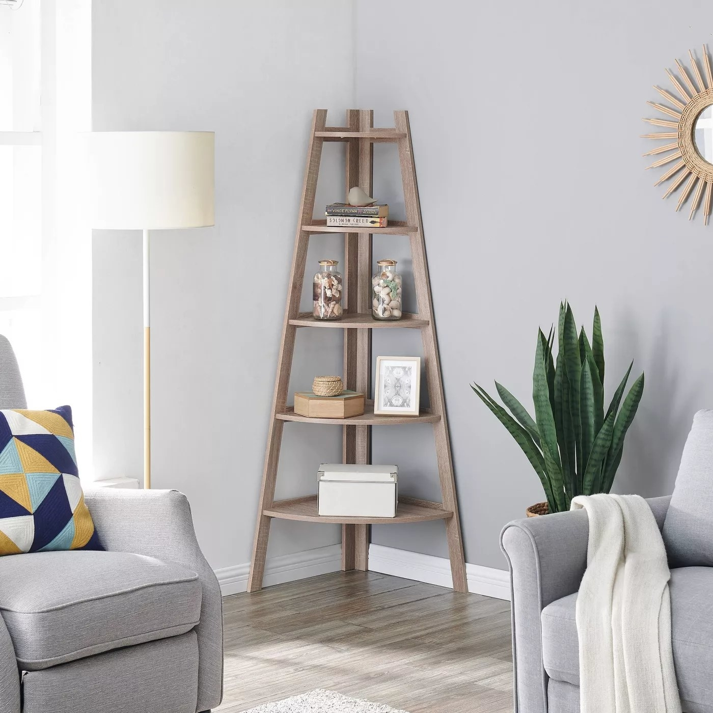 The corner shelf in a living room with five separate shelves