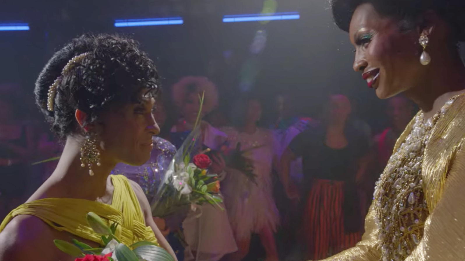 Mj Rodriguez and Dominique Jackson as Blanca Evangelista and Elektra Abundance smiling at each other at a ball
