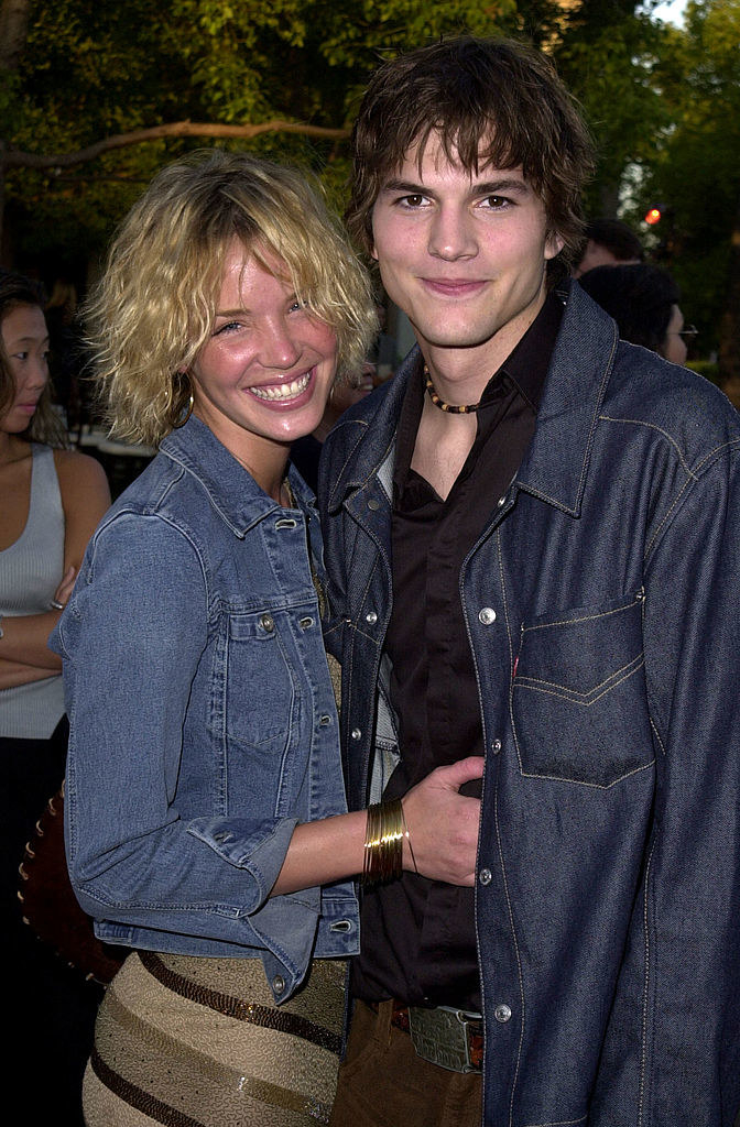 Ashton Kutcher and Ashley Scott absolutely beaming