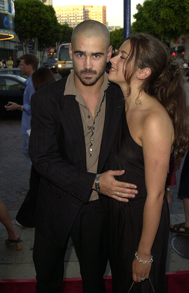 Colin Farrell and Amelia Warner being affectionate