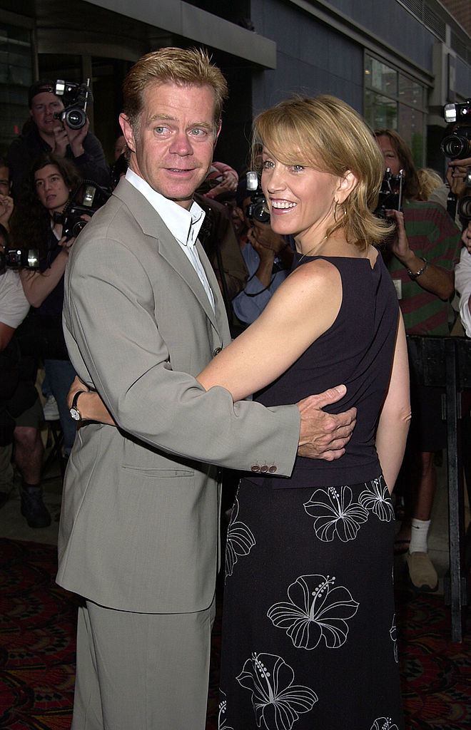William H. Macy and Felicity Huffman on a red carpet hugging it out