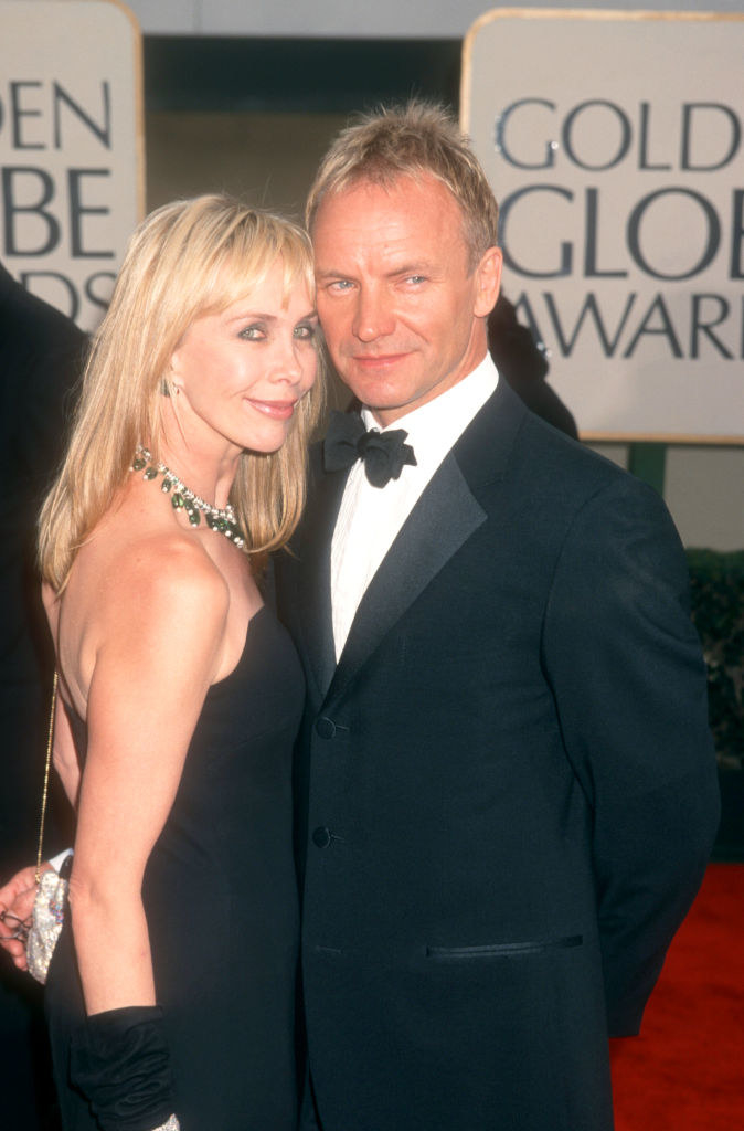 Trudie Styler and Sting embracing at the Golden Globe Awards