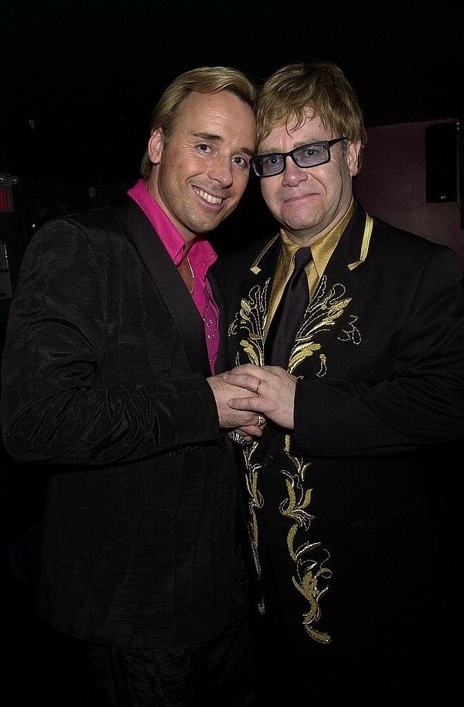 David Furnish and Elton John holding hands
