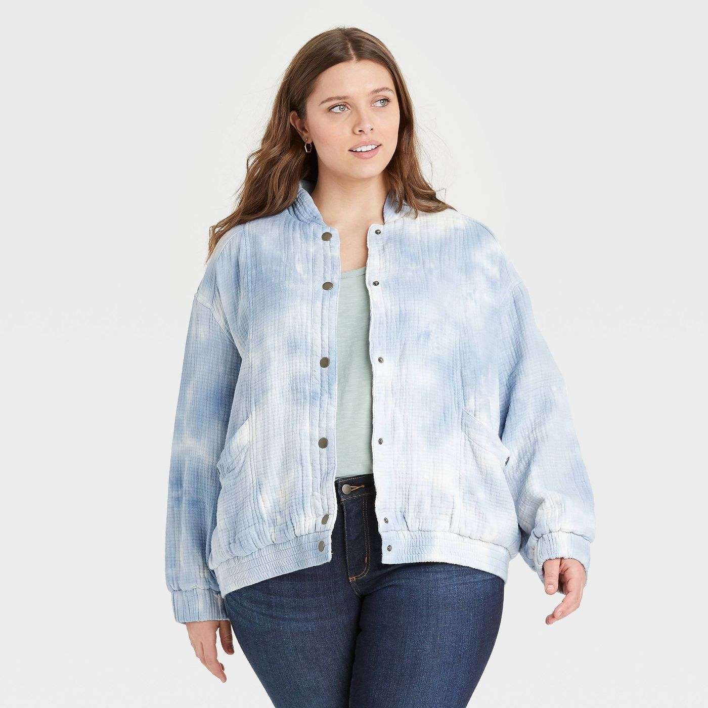 model in light blue tie-dye slouchy button-front jacket with pockets