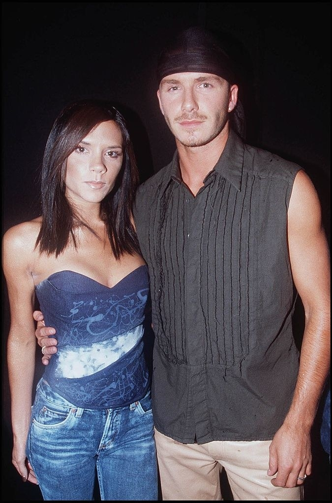 Victoria and David Beckham embracing inthe early 2000s