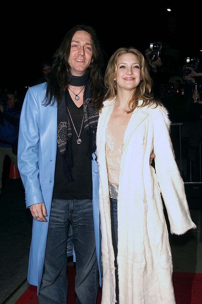 Chris Robinson and Kate Hudson in long, flowy jackets