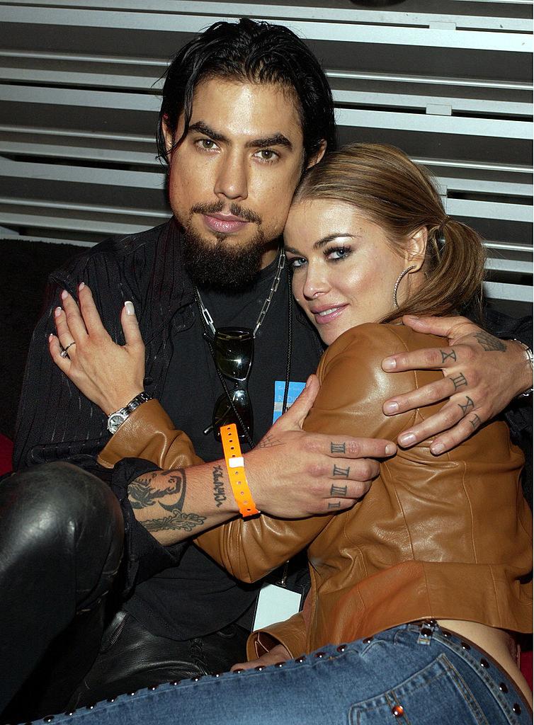 Dave Navarro and Carmen Electra in a deep hug