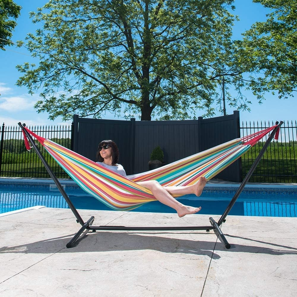 person sitting in the hammock