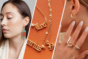 A person wearing a pair of beaded tassel earrings, Three necklaces with the names of different zodiac signs, A person wearing two rings on their hand