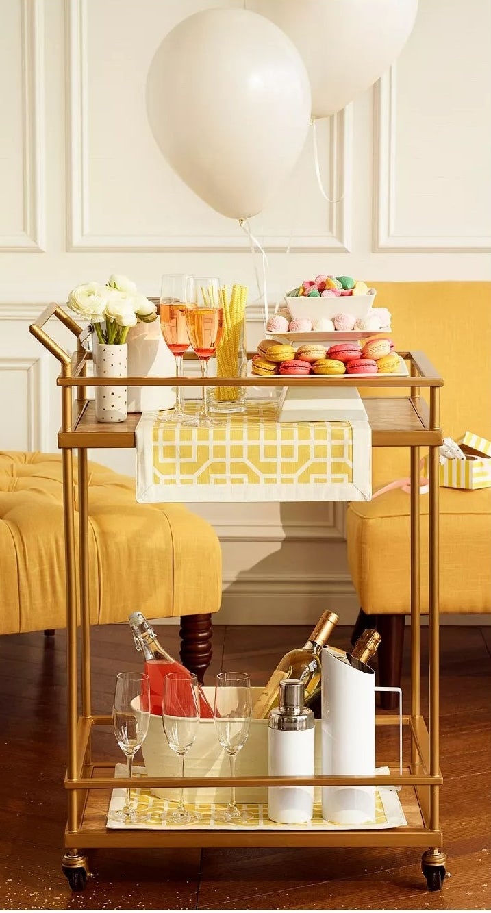 The brass and wood bar cart with two open shelves