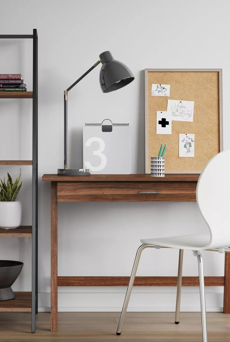 The brown wood desk with one drawer in a home office