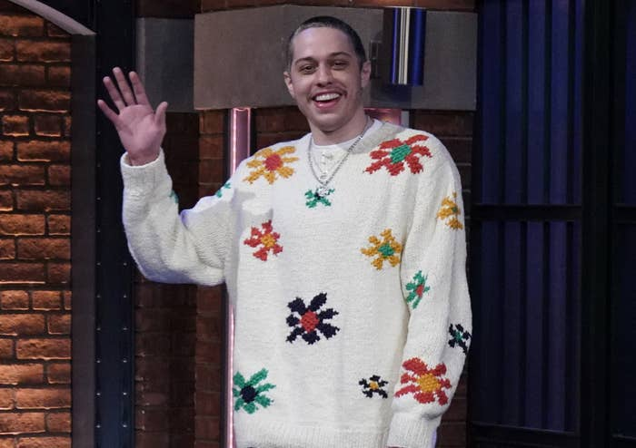 Pete waves while wearing a floral sweater