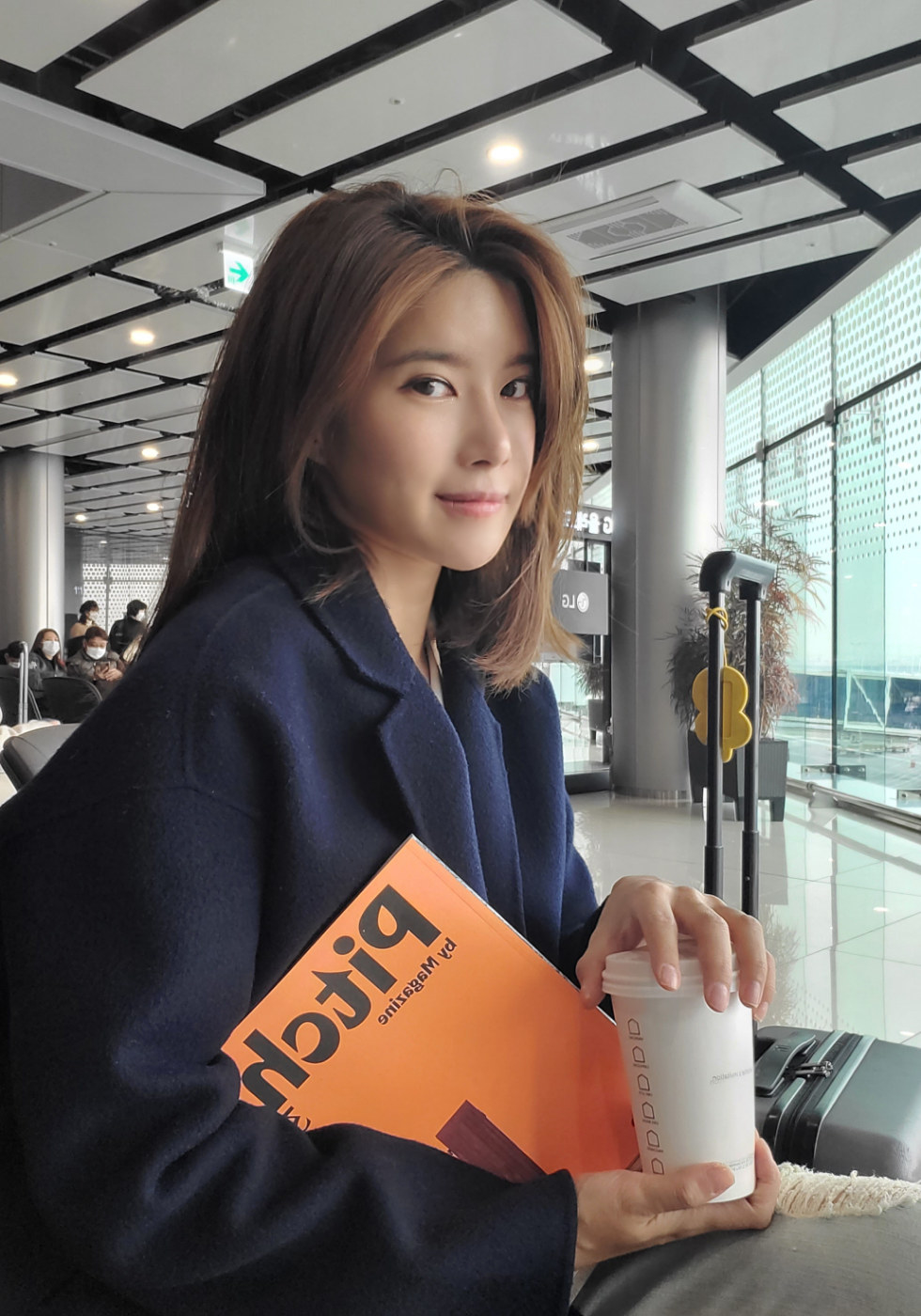 Casual photo of Gina Maeng holding a coffee cup