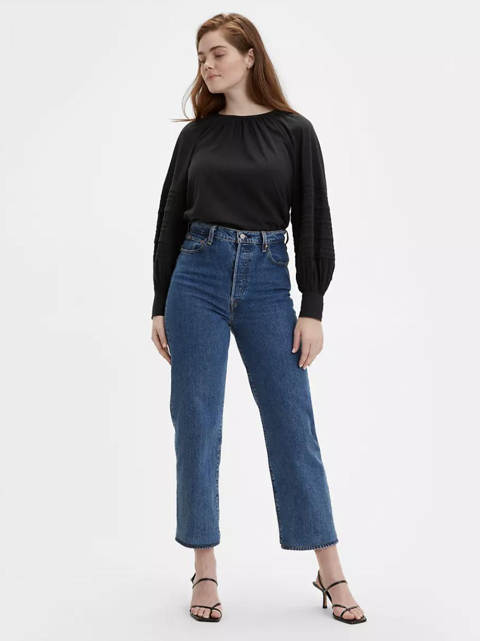 model wearing the medium wash jeans