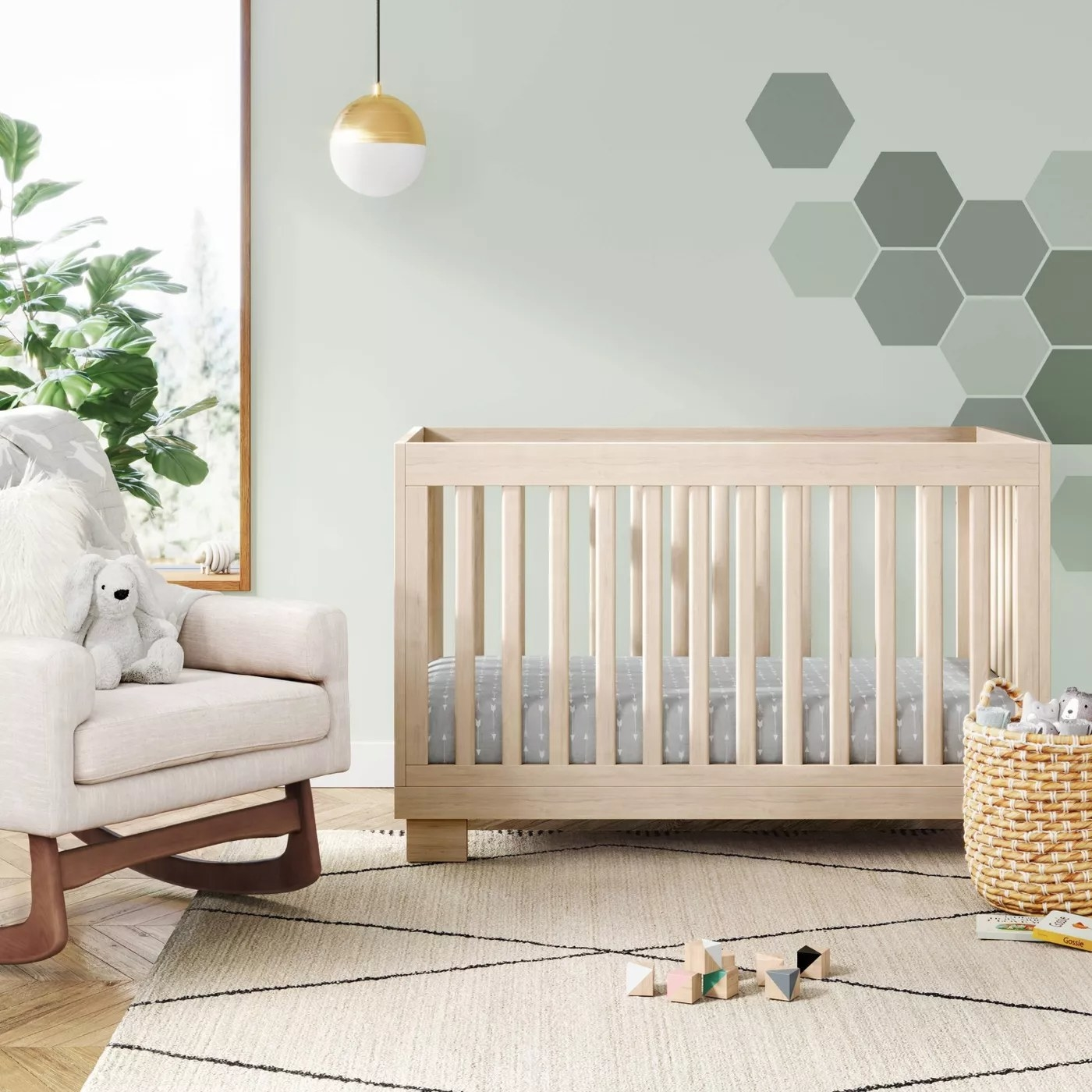 The natural wooden crib in a nursery