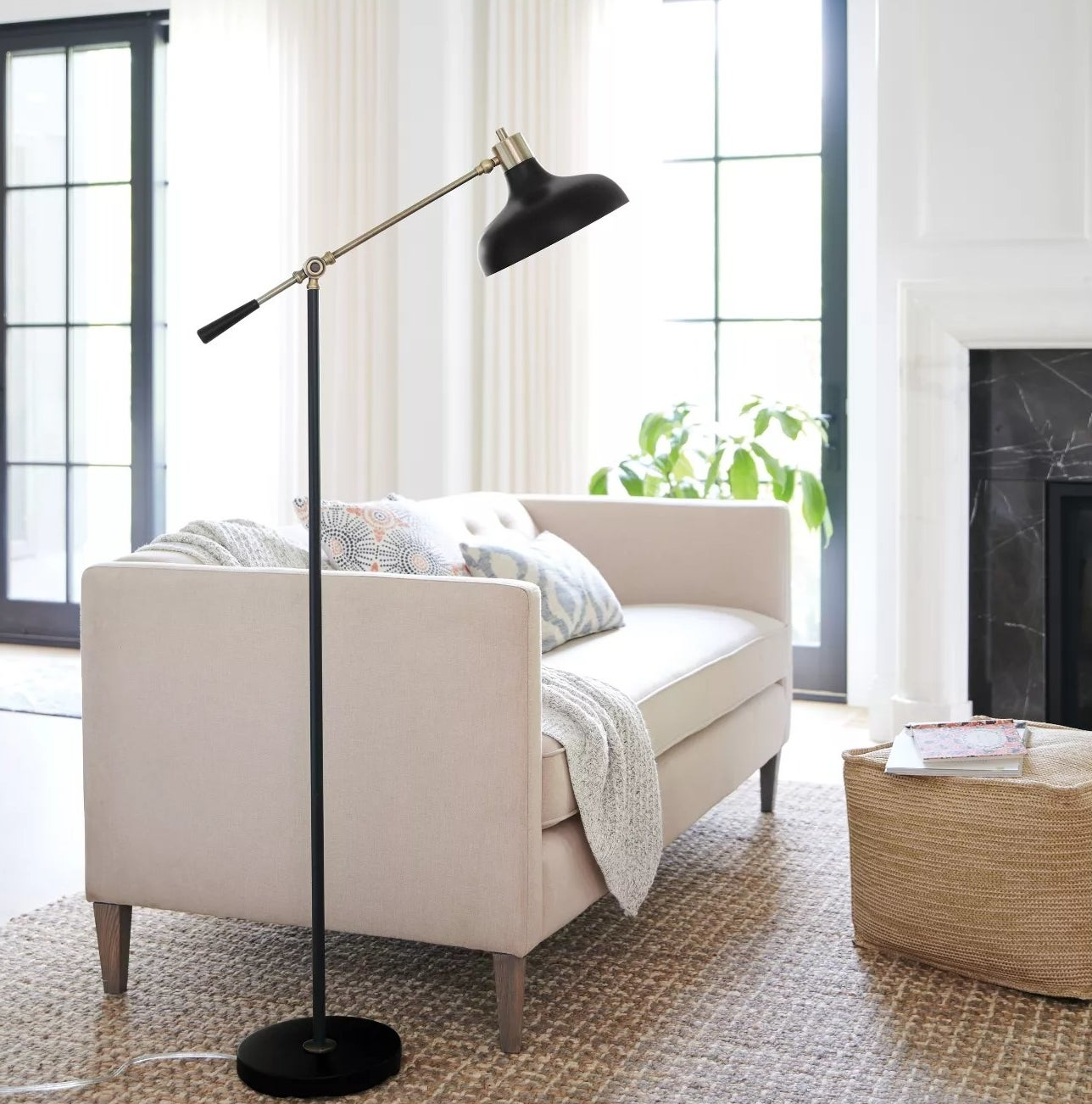 The lamp with an adjustable arm and circular base in a living room
