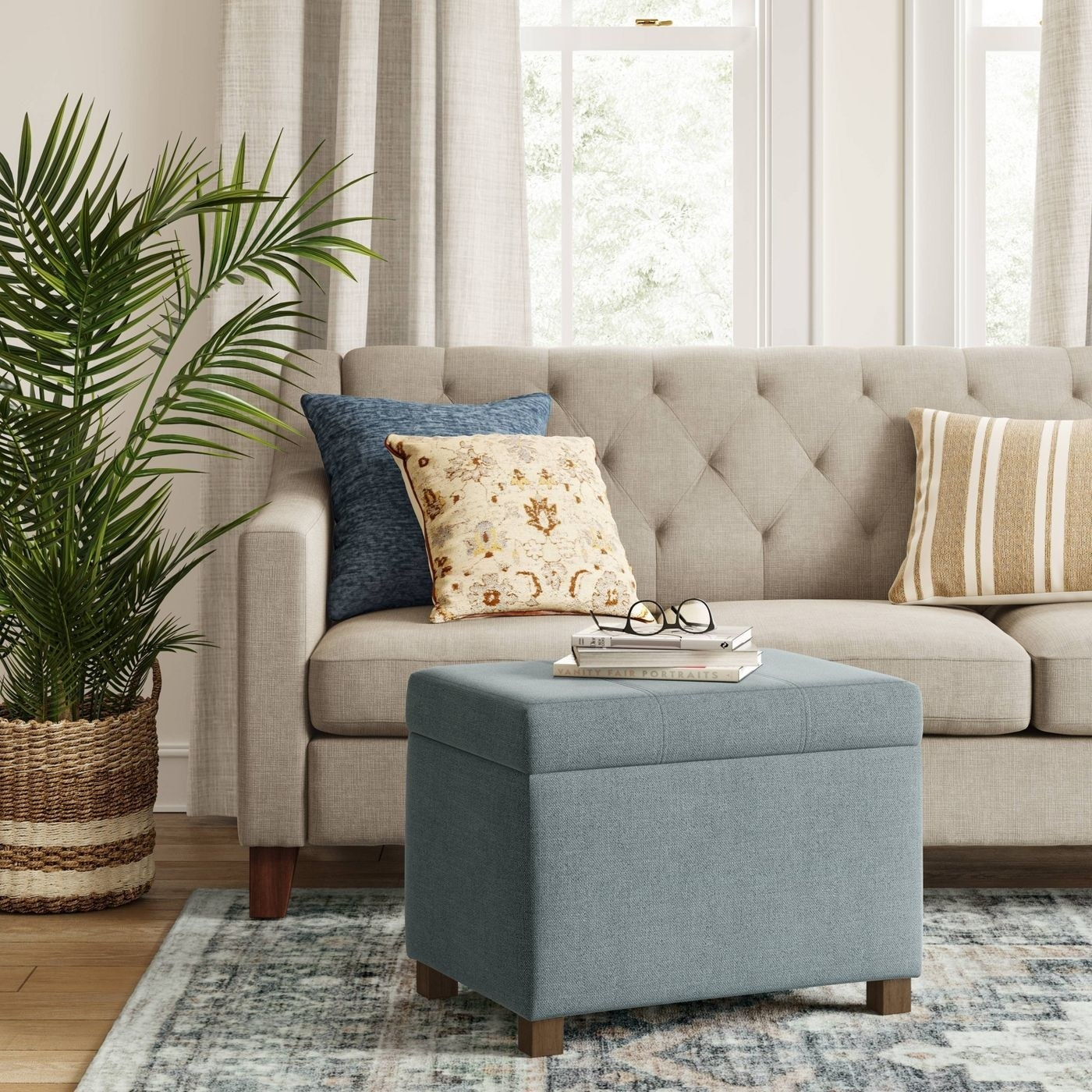 light blue upholstered rectangular ottoman with lid in a room