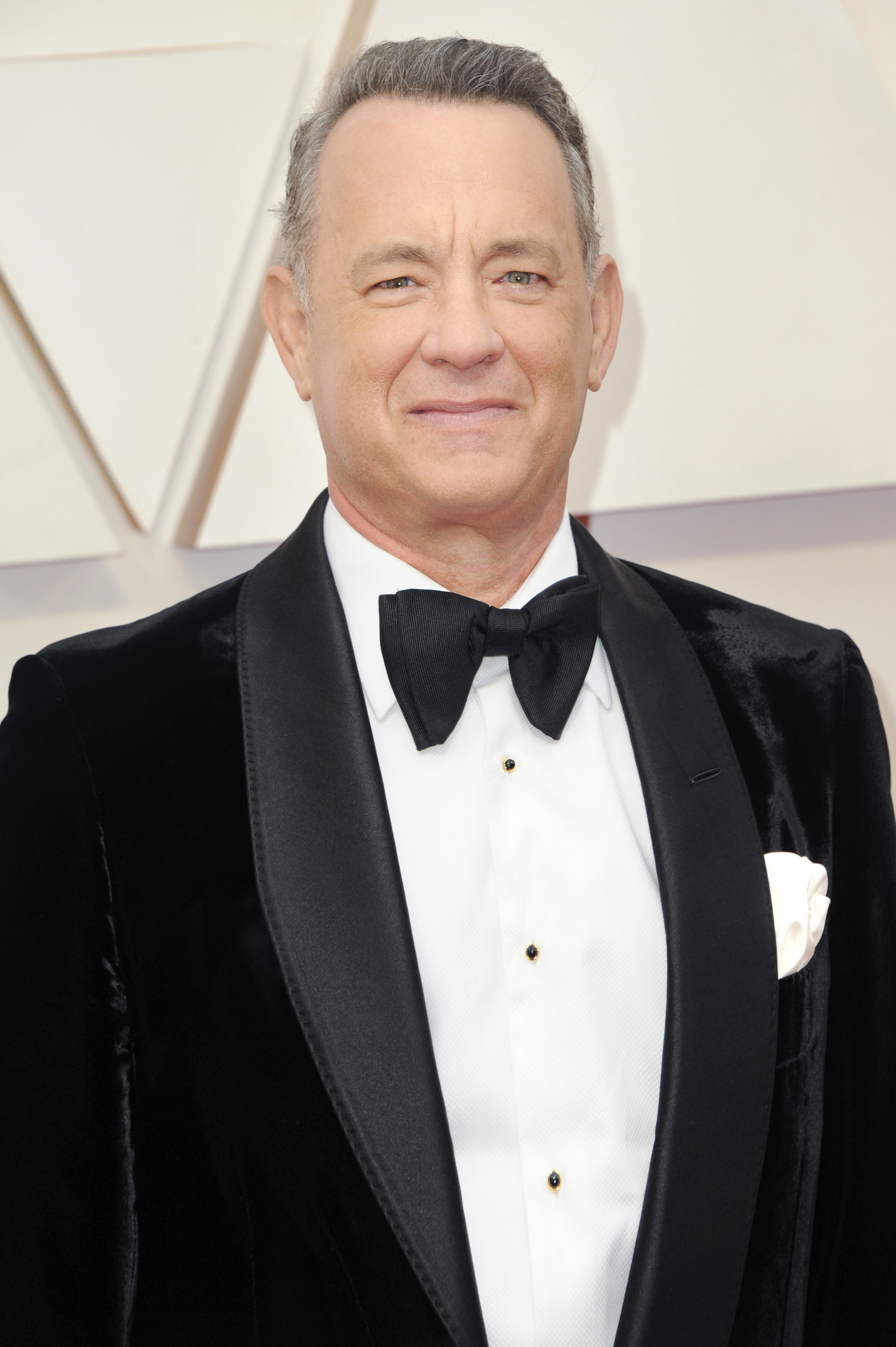Photo of Tom Hanks in a dressy suit and bow-tie