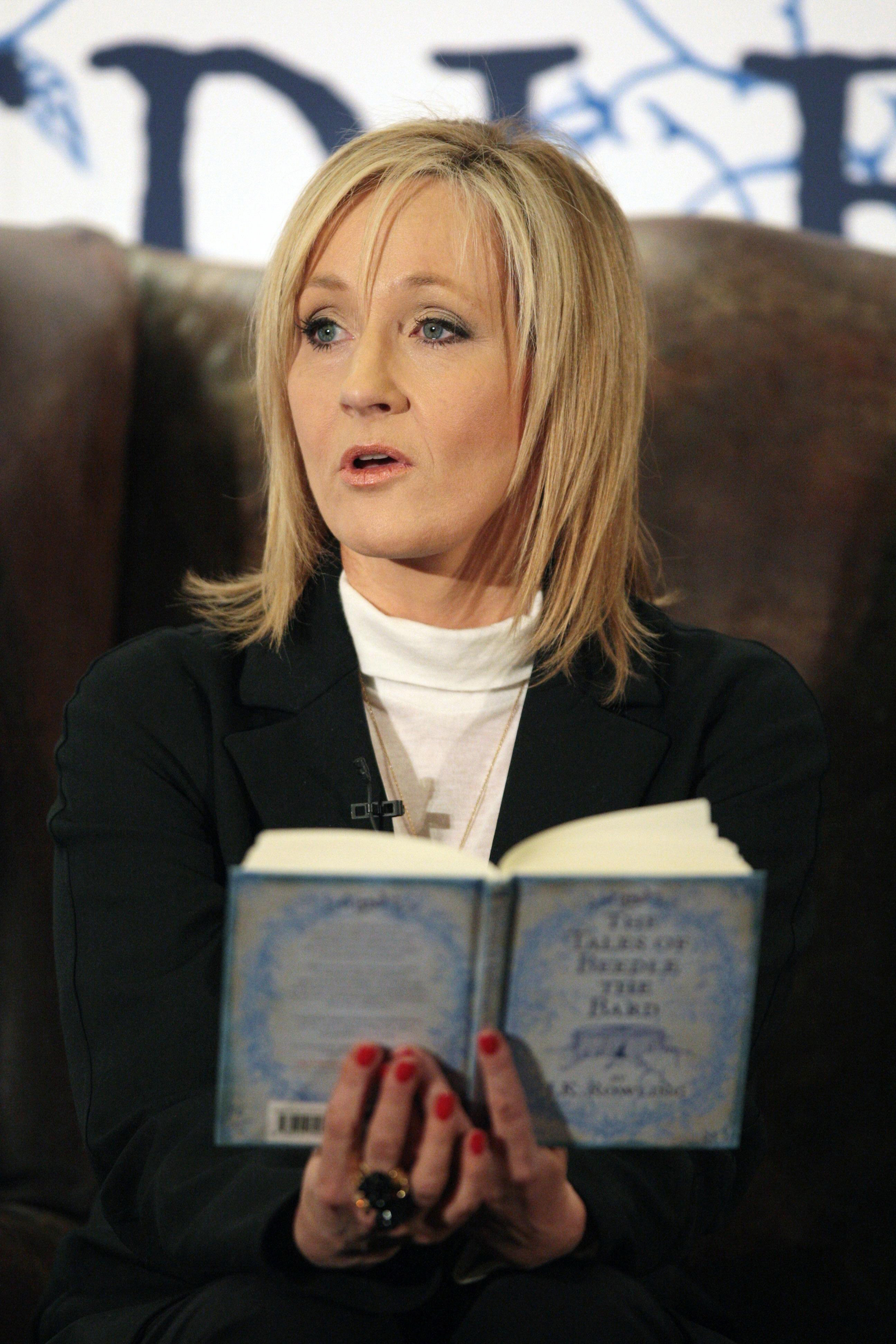 Photo of J.K. Rowling reading a book