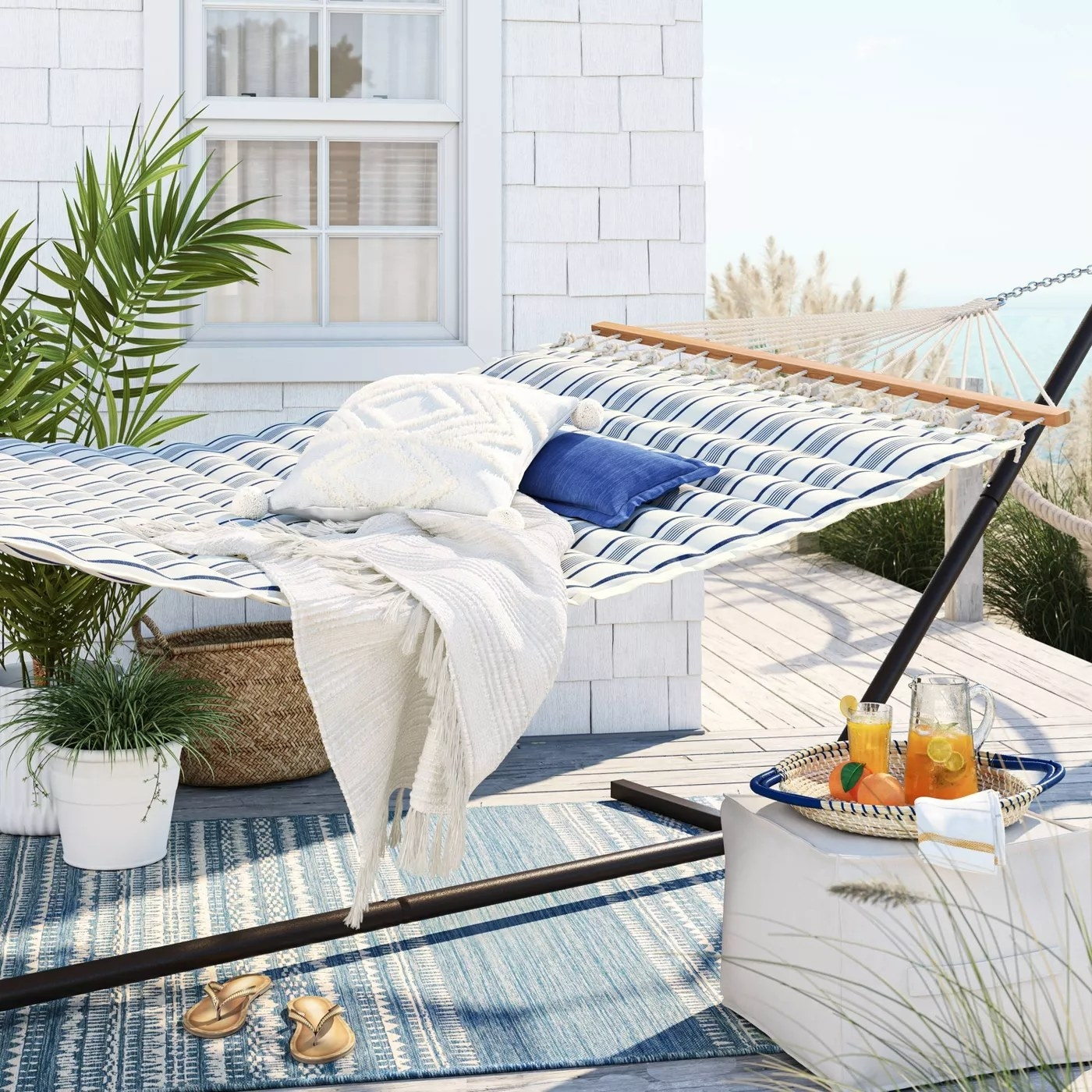 The hammock with a padded top set up on a deck
