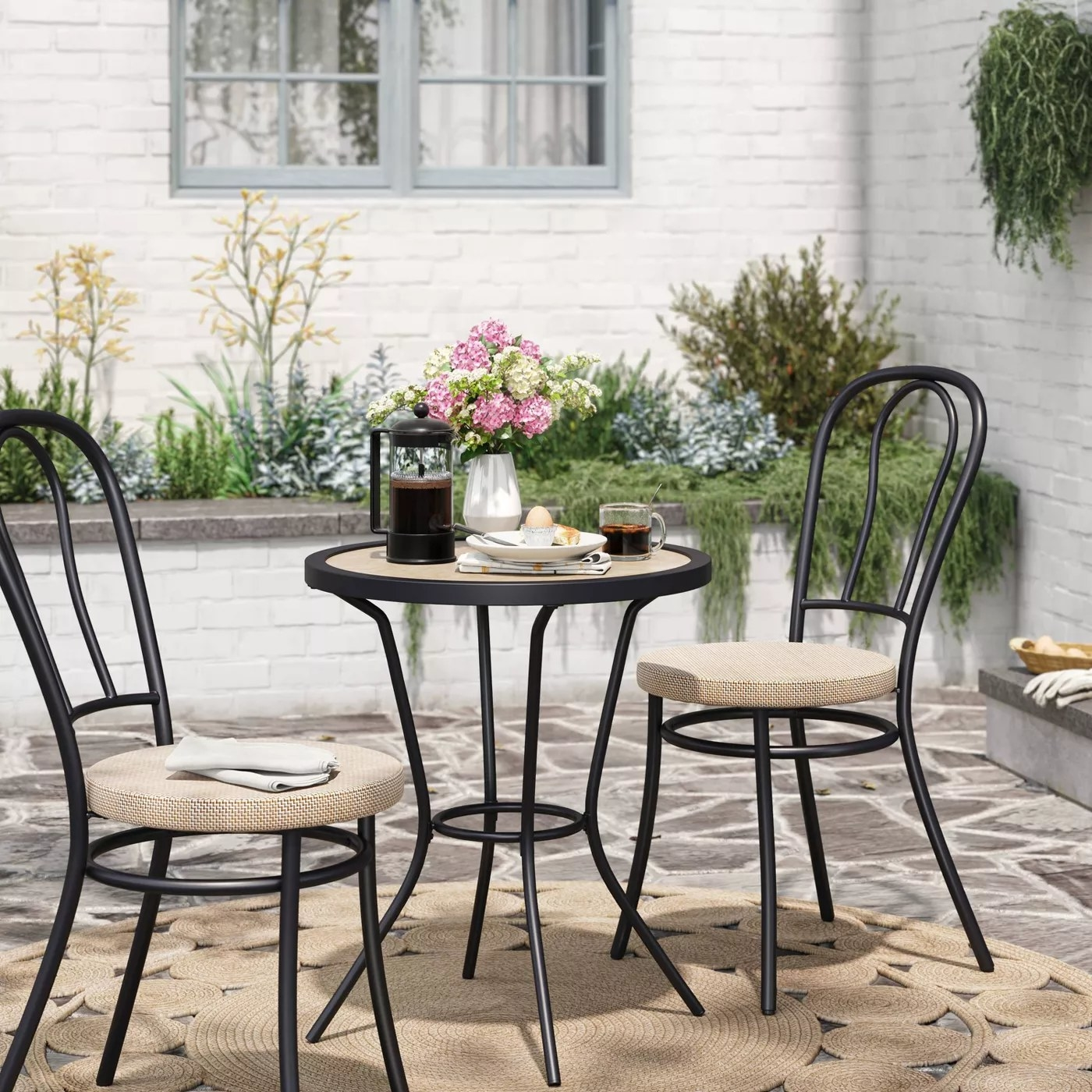 The black and wood patio set in a backyard