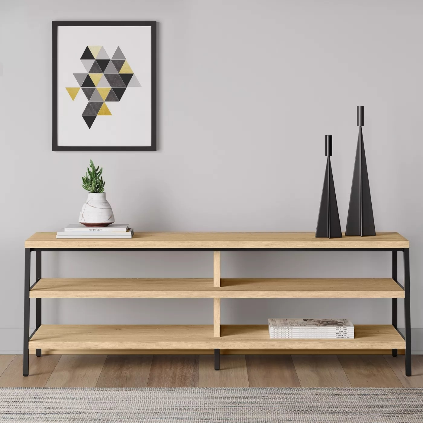 The TV stand with three long and narrow shelves