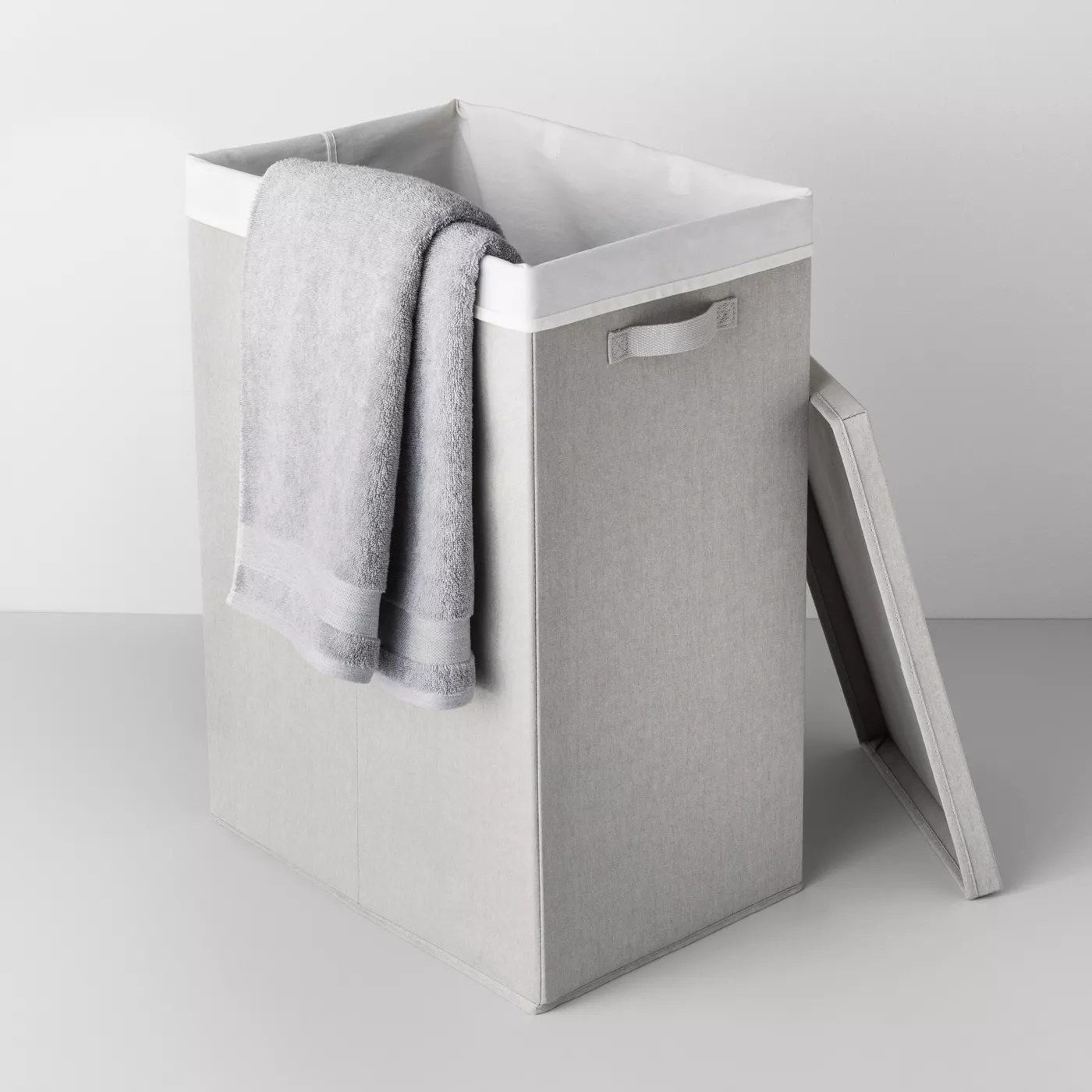 The rectangular hamper with a lining, side handle and matching top
