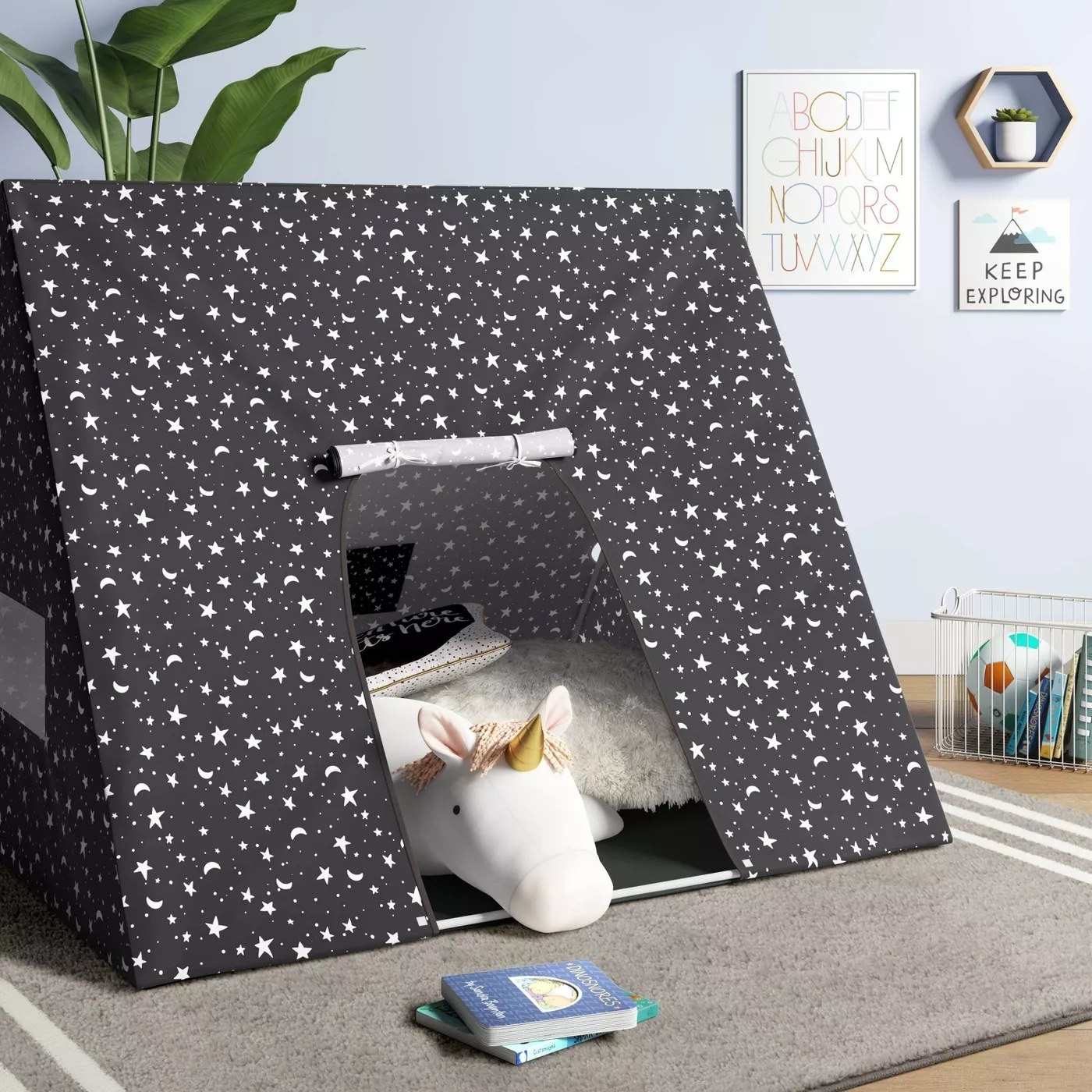 The tent with an entrance flap in a playroom