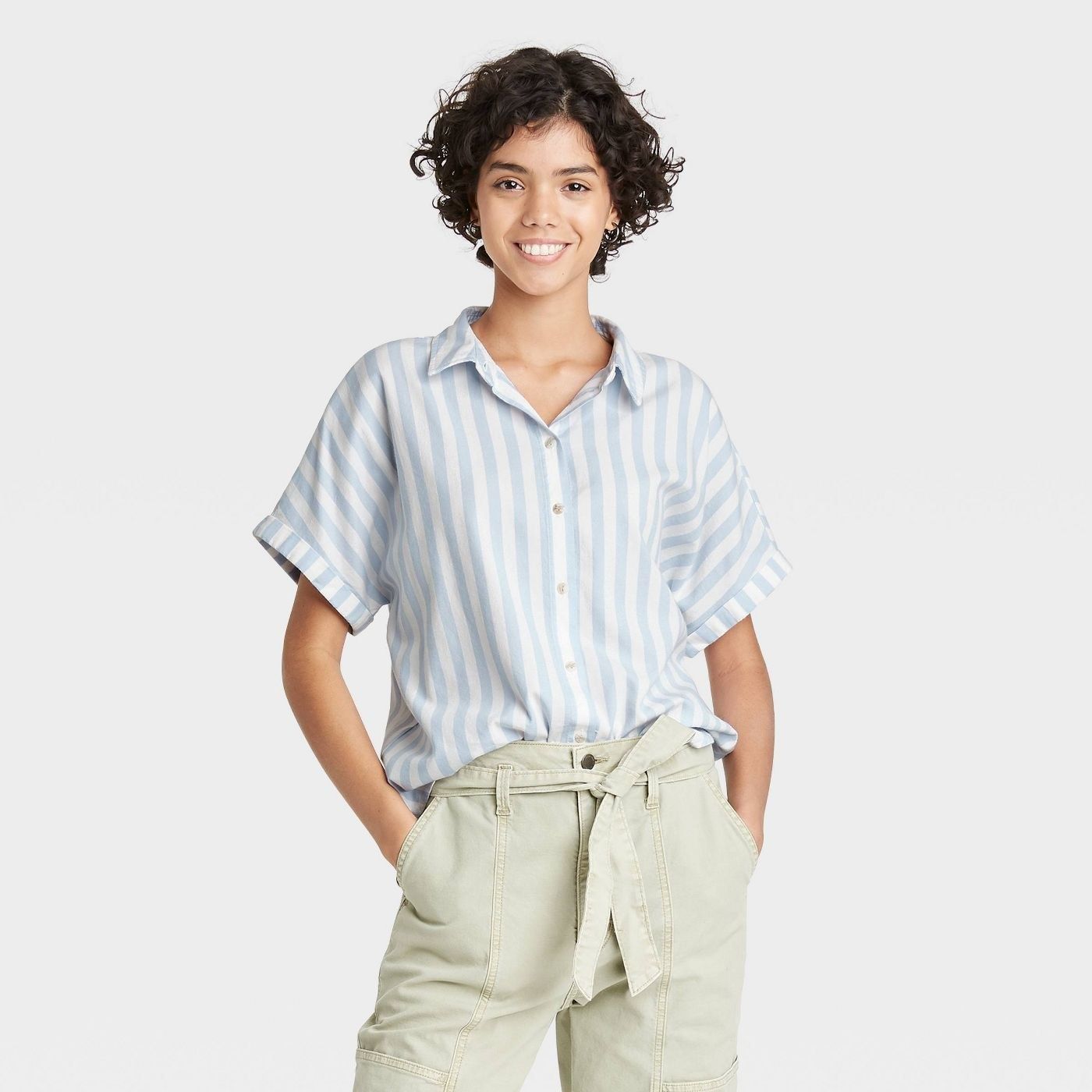 a model wearing the blue striped short sleeve button-down with khakis