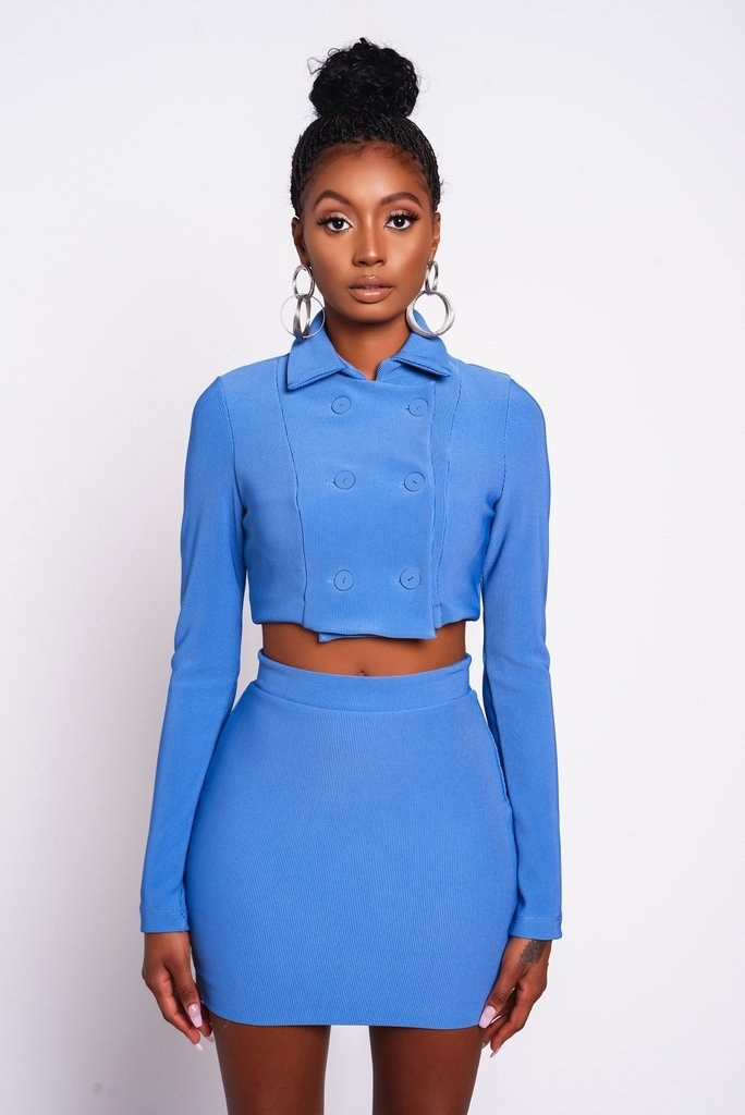 a model wearing the blue cher crop jacket in a small