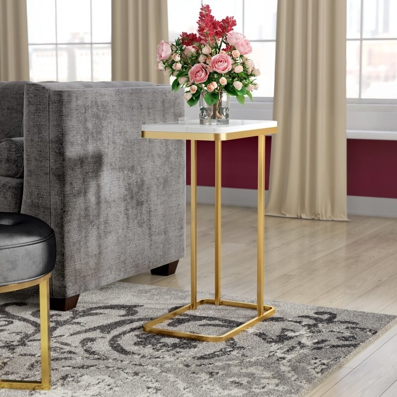 Side table with white rectangular metal top