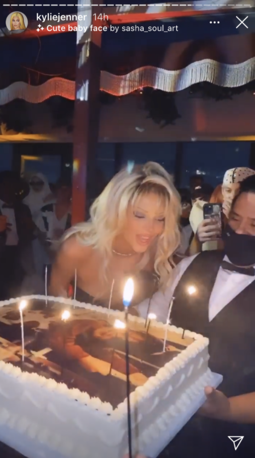 Kendall Jenner blowing out the candles on her birthday cake