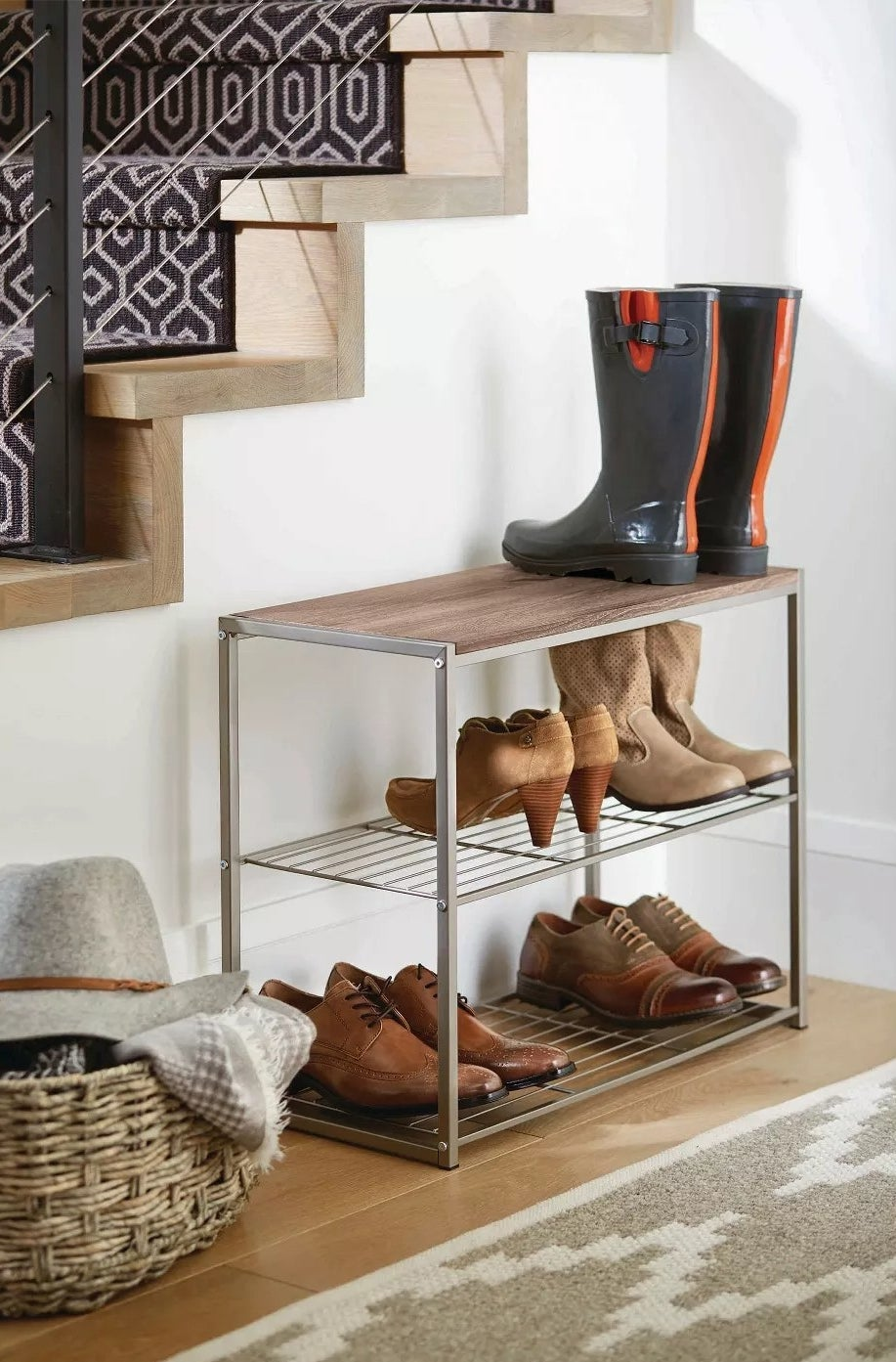 The shoe rack with three tiers in an entryway