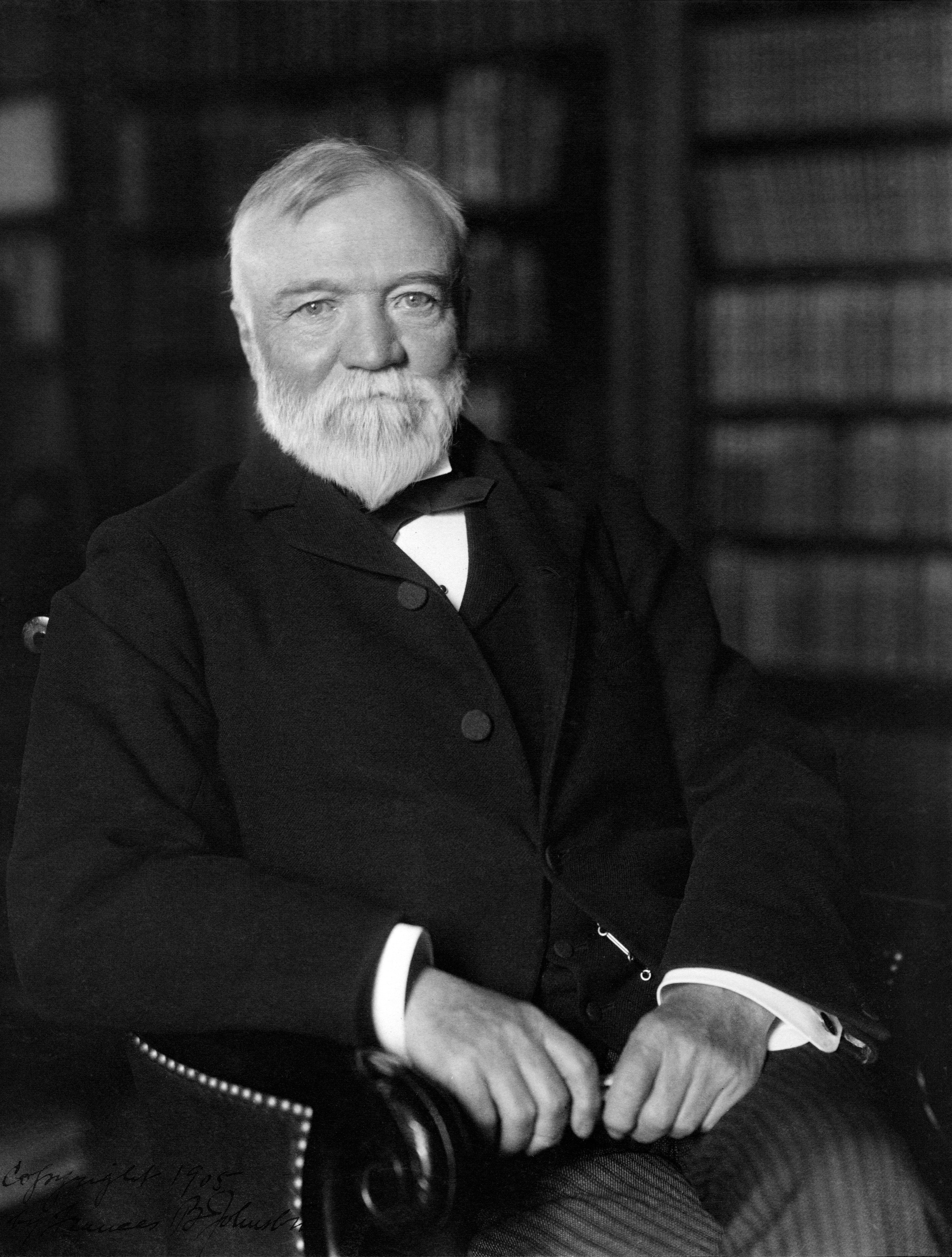 Black-and-white photo of Andrew Carnegie sitting in a chair