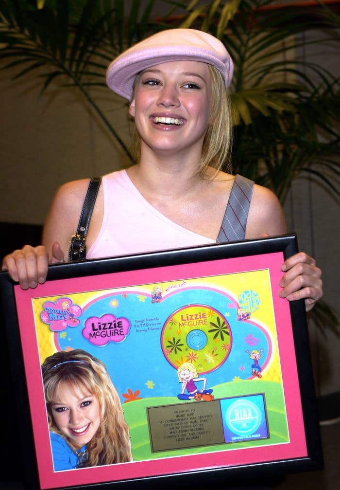 Hillary holding a Lizzie McGuire plaque