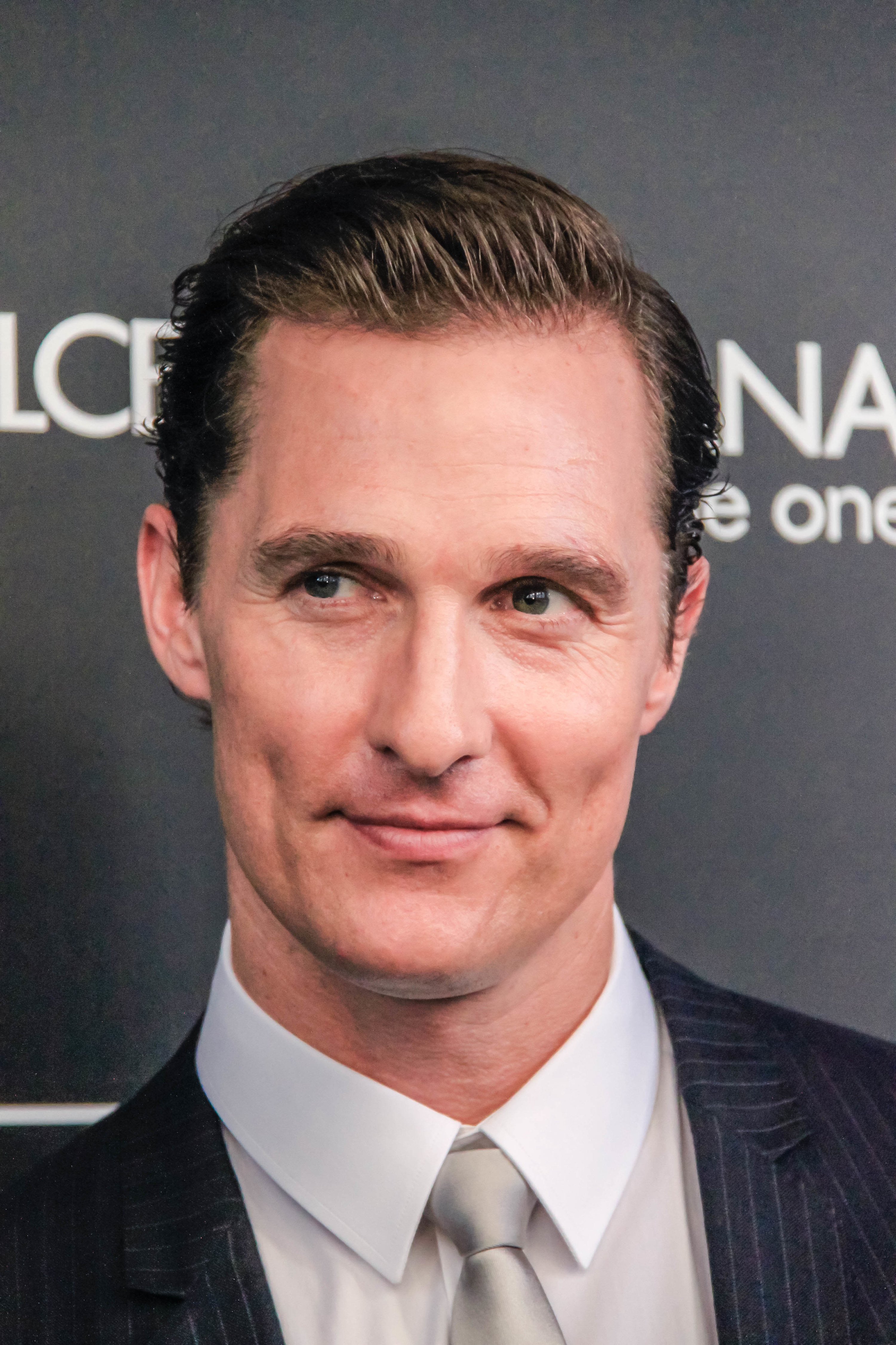 Photo of Matthew McConaughey in a suit with slicked back hair