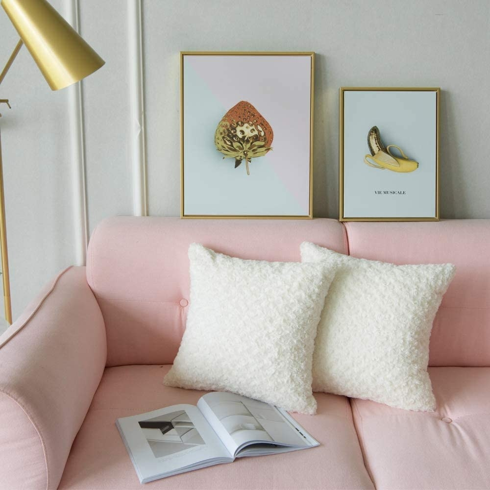 plush faux fur white pillows on a baby pink couch