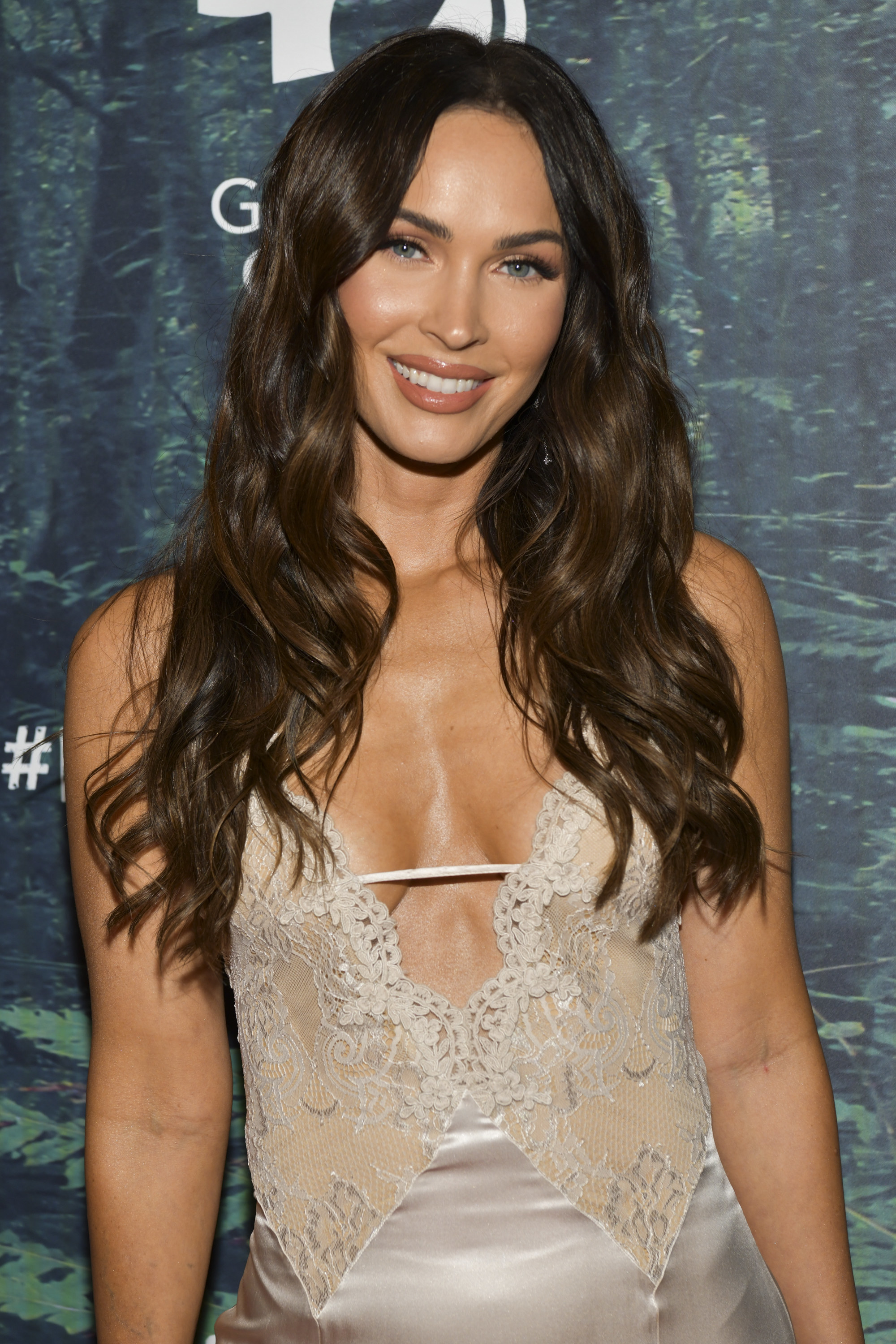 Photo of Megan Fox in a lace dress at a movie premiere