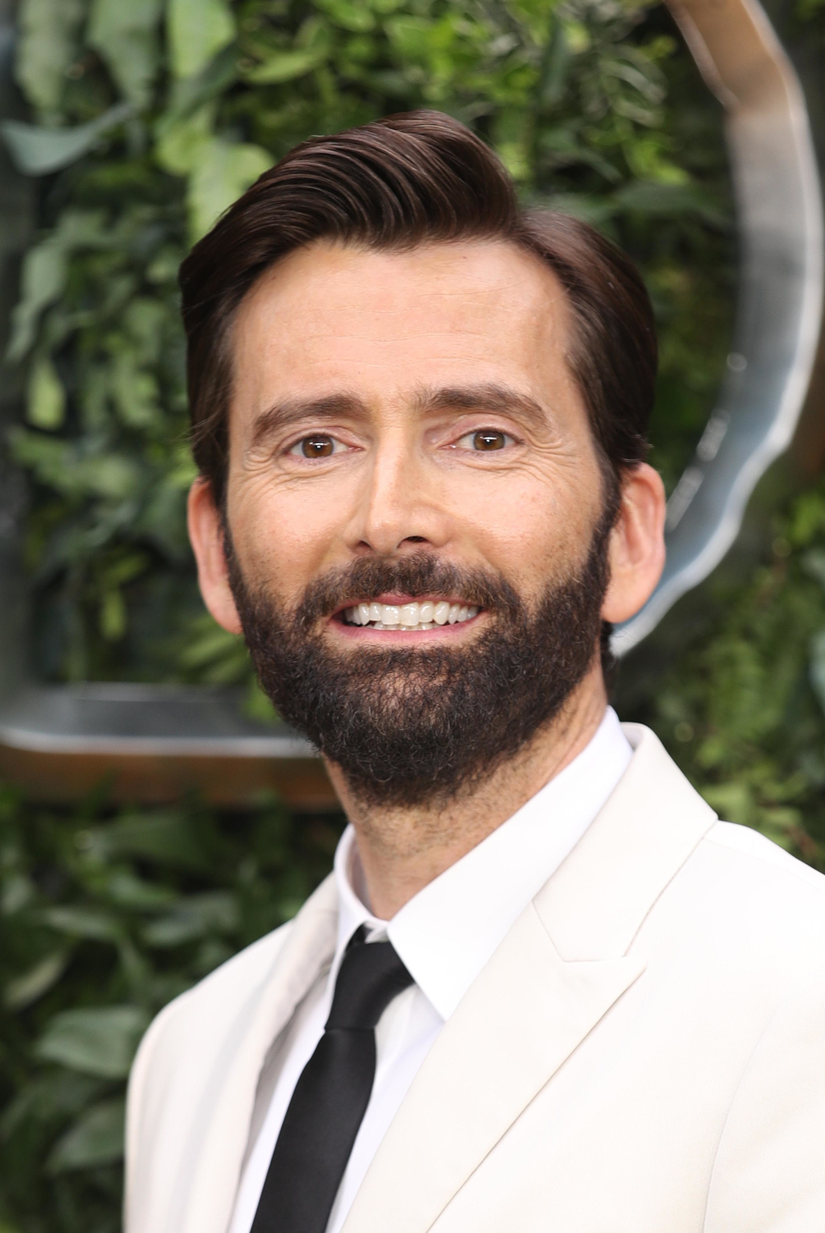 Photo of David Tennant in a white suit