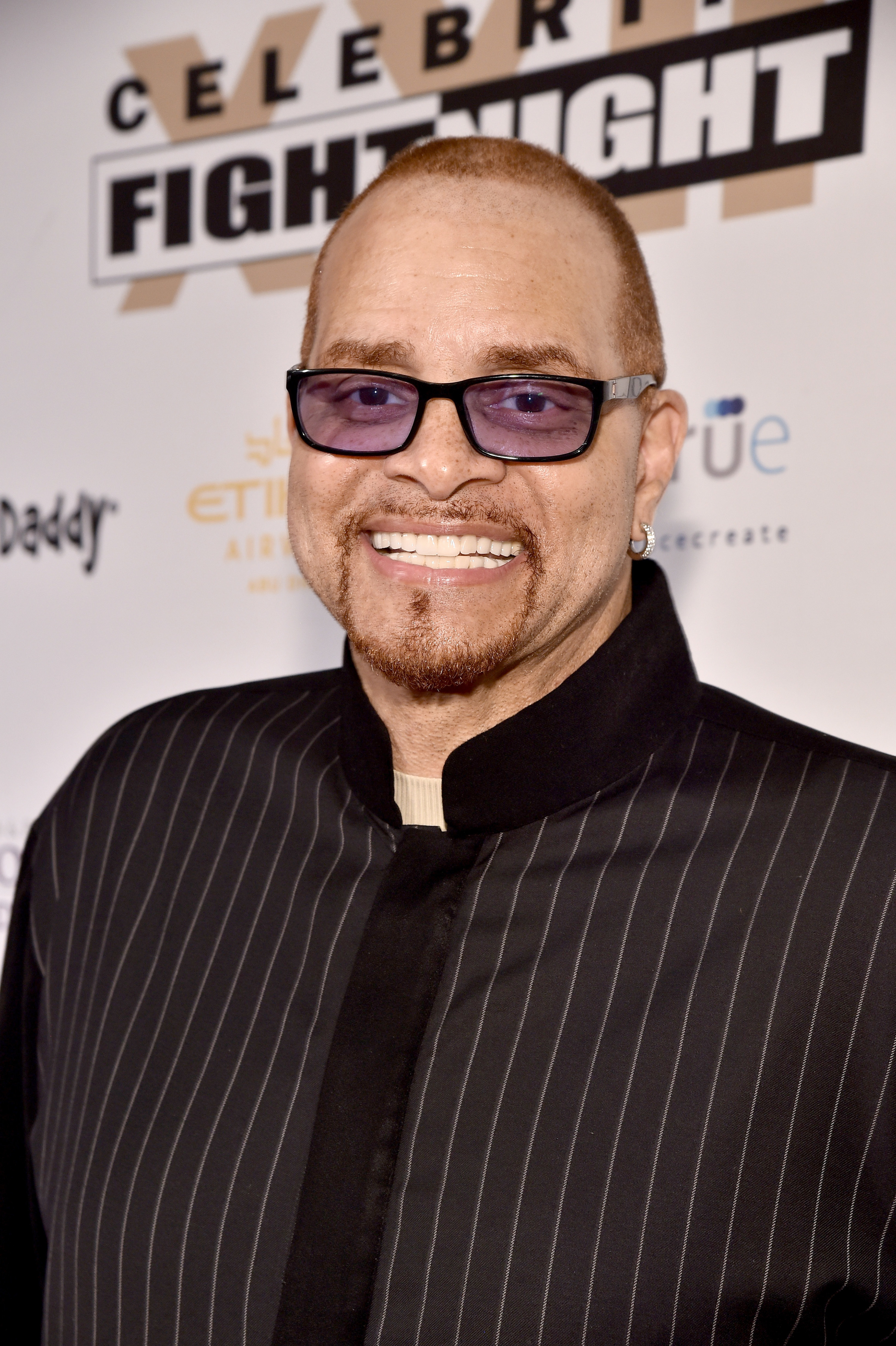 Photo of comedian Sinbad in a pin-striped jacket and black glasses