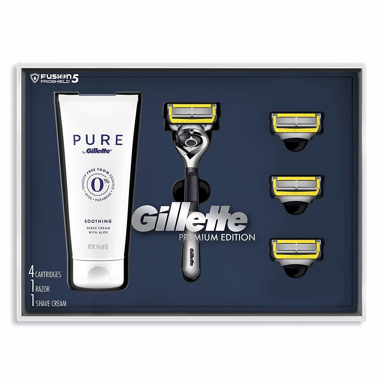 the shaving kit in box (shaving cream, razor, and three razor heads)