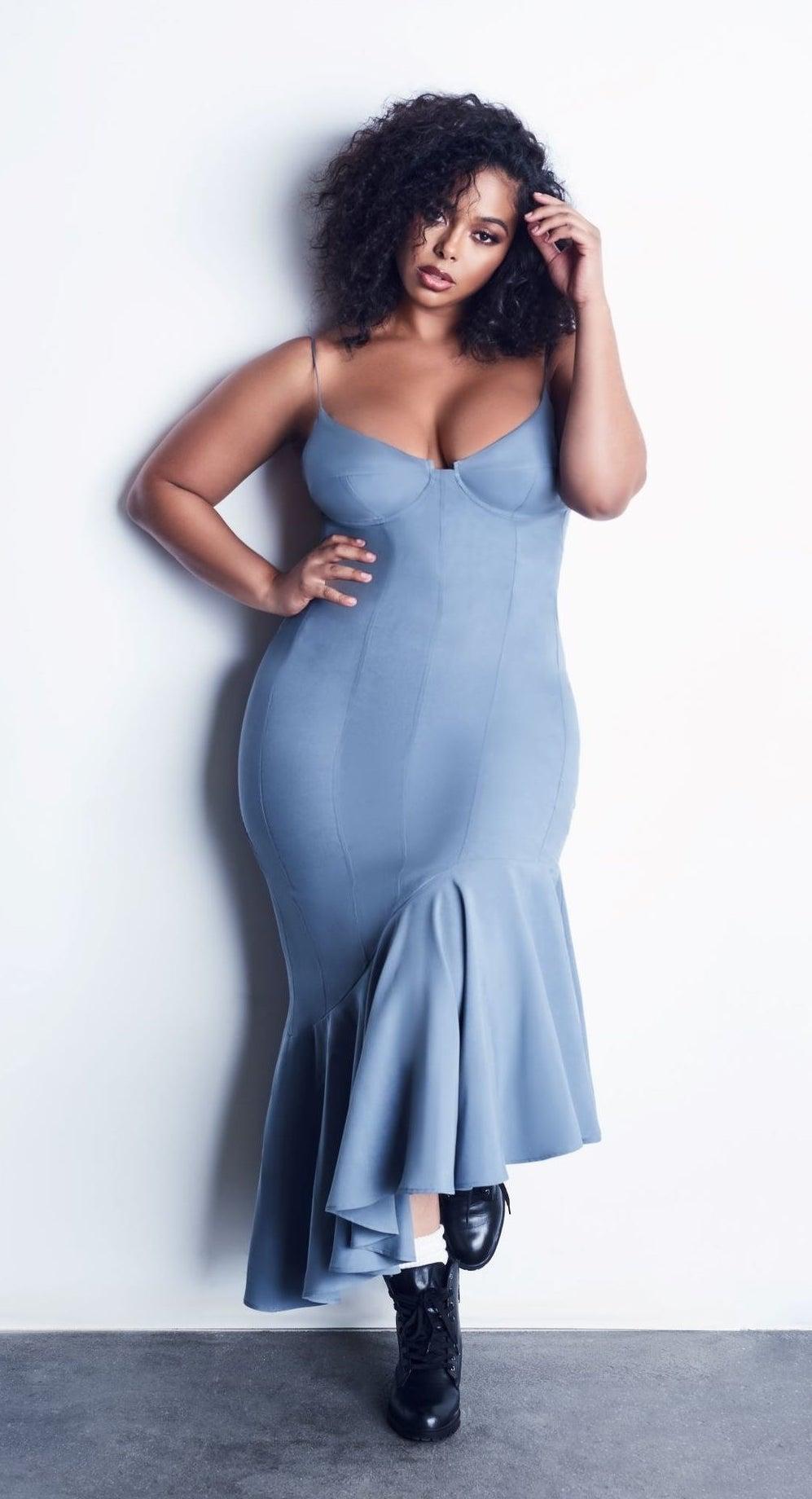 model wearing the blue dress