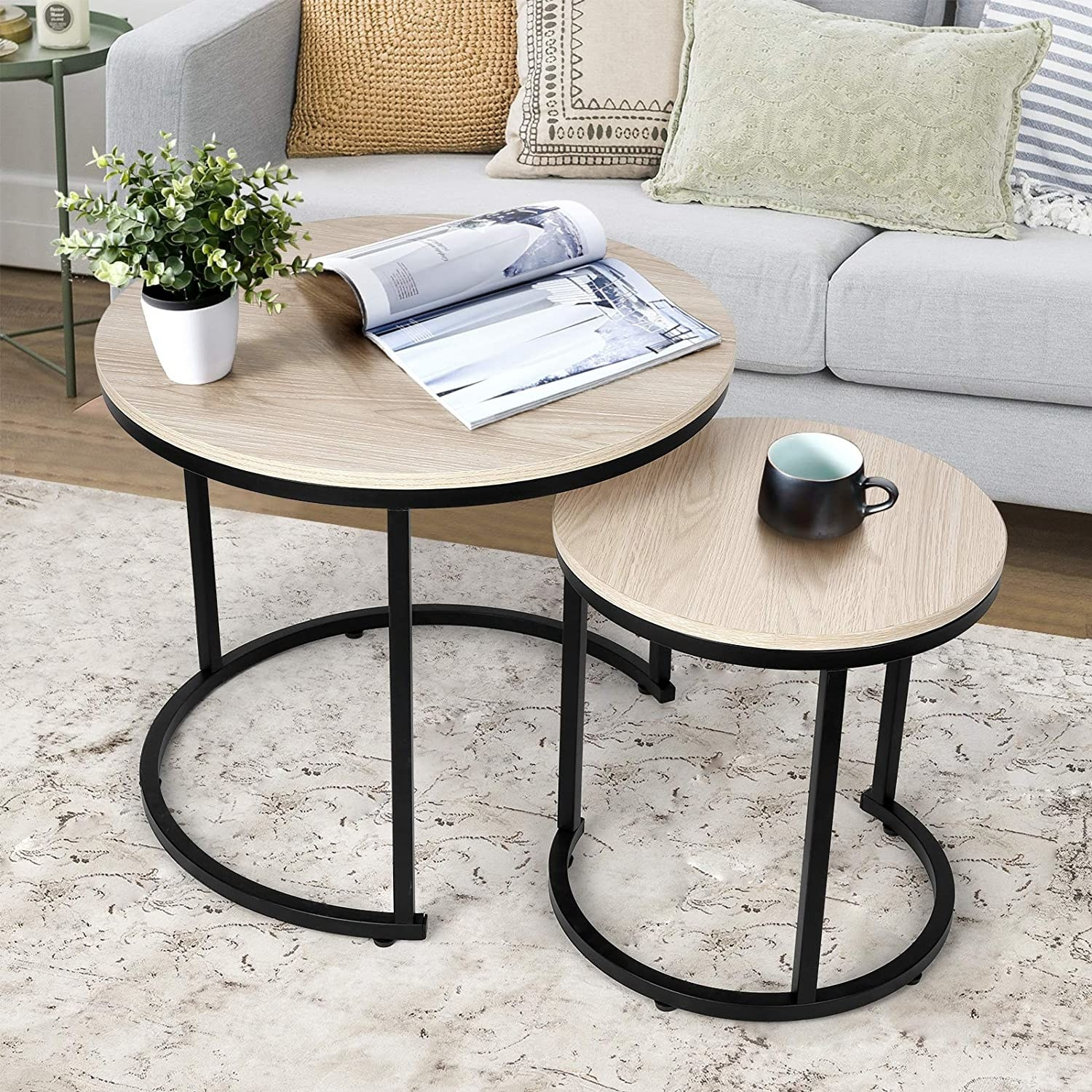 black and light wood nesting tables next to a gray couch