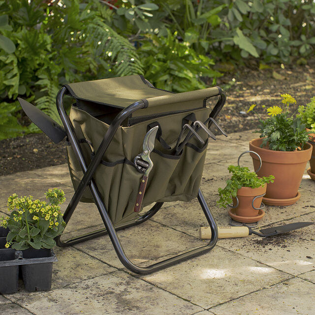 gardener's tool seat in garden with tools in the side pockets