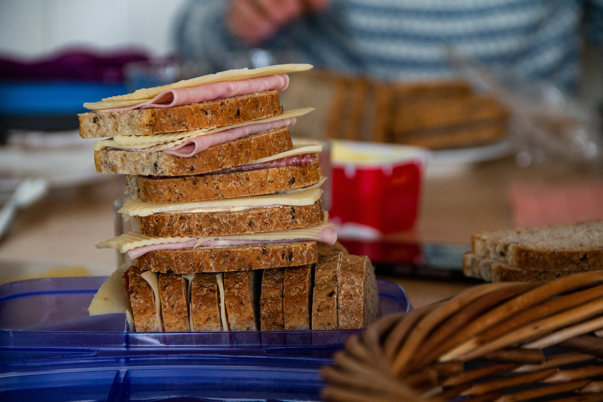 A stack of breads and sandwich meats