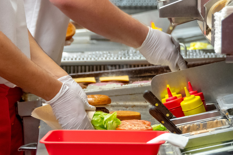Fast-food workers making burgers