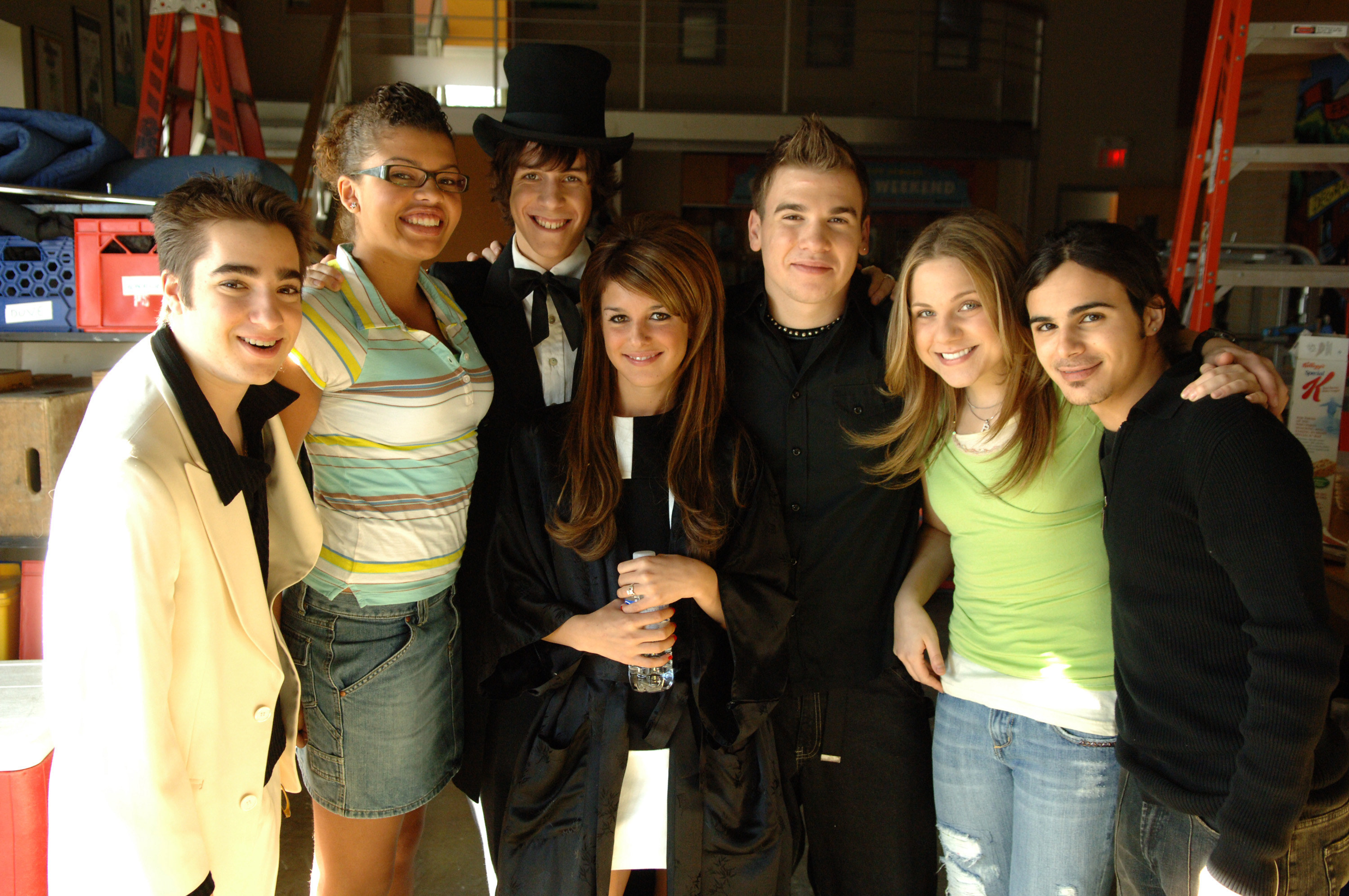 A portion of the cast pose for a photo on set