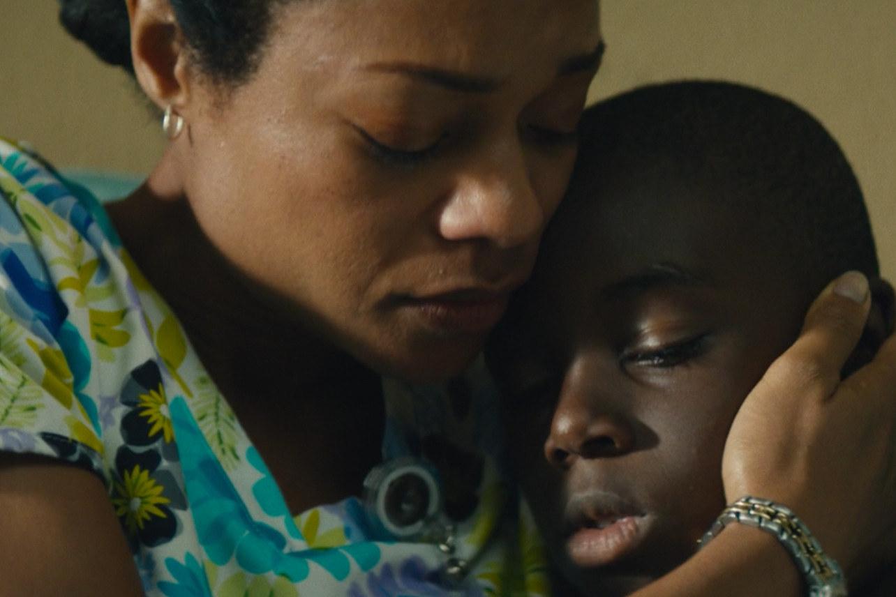 Naomie Harris hugs her child in Moonlight